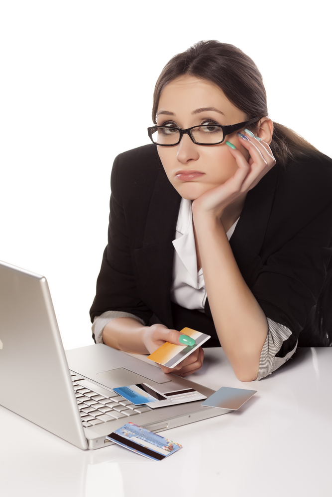 Business woman waorried about credit card debt